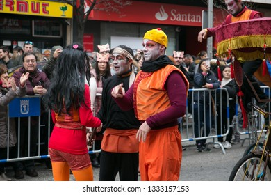 Madrid, Spain - February 10, 2019: actors dressed in traditional dresses and juggling the celebration of the Chinese New Year parade
