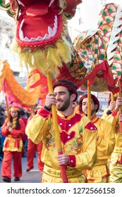 MADRID SPAIN - FEBRUARY 18. Parade for the celebration of the Chinese New Year. People wearing traditional Chinese costumes celebrating in the streets