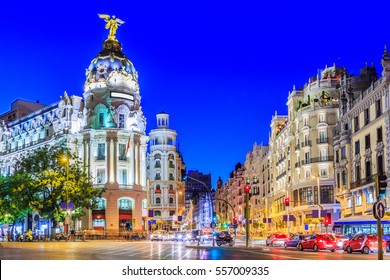 Madrid, Spain. Gran Via, main shopping street at twilight.