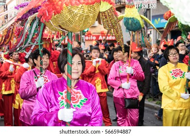 MADRID SPAIN - JAN 28. Chinese New Year Celebration Parade on the streets on January 28, 2017 in Madrid, Thousands of citizens of Chinese origin celebrate the arrival of the Year of the Rooster