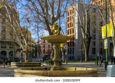 MADRID, SPAIN - JANUARY 1, 2018: View of fountains in Paseo del Prado boulevard, with locals and visitors, in Madrid, Spain