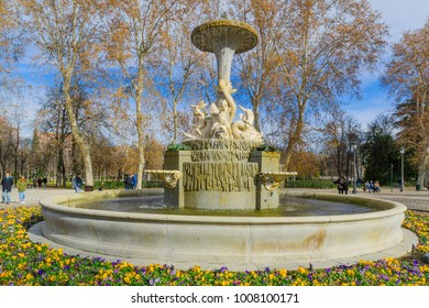 MADRID, SPAIN - JANUARY 1, 2018: View of the Fuente (fountain) de los Galapagos, with locals and visitors, in the Buen Retiro Park, Madrid, Spain