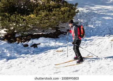 MADRID, SPAIN - JANUARY 17, 2018: Person practicing mountain skiing in the Sierra de Guadarrama in Madrid, JAN 17, 2018 in Madrid, Spain