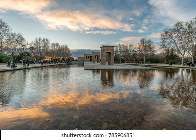 Madrid, Spain - January 2, 2018 : Sunset sky clouds reflections at Templo de Debod (Debod Temple) downtown Madrid. Egyptian temple dedicated to the goddess Isis