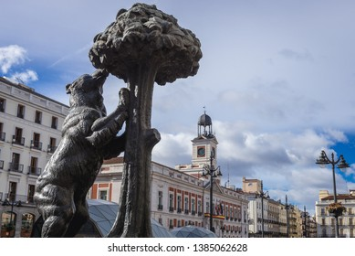 Madrid, Spain - January 22, 2019: Famous statue of wild bear and strwaberry tree represents the heraldic symbols of Madrid coat of arms, located on Sol Square
