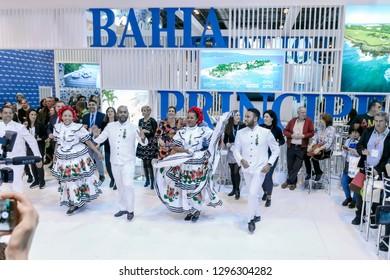 Madrid, Spain - January 25, 2019 - Bahia Principe promotional stand with folk dancers at FITUR International Tourism Fair un Madrid city