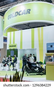 Madrid, Spain - January 25, 2019 - Goldcar promotional stand at FITUR International Tourism Fair in Madrid city
