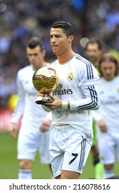 MADRID, SPAIN - January 25th, 2014 : Portuguese CRISTIANO RONALDO of REAL MADRID holds Ballon Dor 2013 FIFA Award (Ball of Gold) as best player of the world at Santiago Bernabeu Stadium.