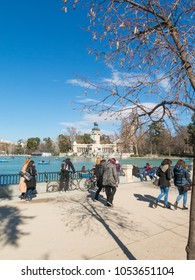 Madrid, Spain - January 27, 2018: Beautiful picture of tourists at pond of the Parque del Buen Retiro - Park of the Pleasant Retreat in Madrid, Spain