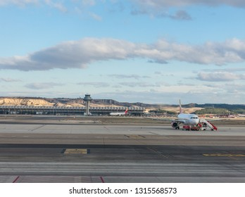 Madrid, Spain - January 27, 2018: A plane prepares to take off on the runway of Terminal T4 the Adolfo Suarez Madrid Barajas Airport. Barajas is the main international airport serving Madrid in Spain.