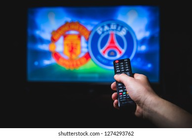 MADRID, SPAIN, JANUARY. 3. 2019: Watching Football on TV and using remote controller, Champions League, UCL, Round of 16, Manchester United (ENG) vs Paris Saint-Germain (FRA),