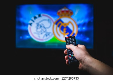 MADRID, SPAIN, JANUARY. 3. 2019: Watching Football on TV and using remote controller, Ajax (NED) v Real Madrid (ESP)