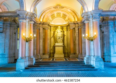 MADRID, SPAIN, JANUARY 9, 2016: View of the main decorated lobby with a staircase in the Royal Palace of Madrid. It is popular tourist attraction.