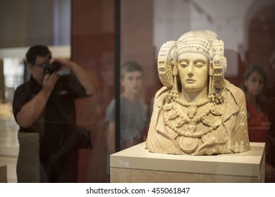 Madrid, Spain - July 10, 2016: Visitors taking pictures Lady of Elche at National Archeological  Museum of Madrid