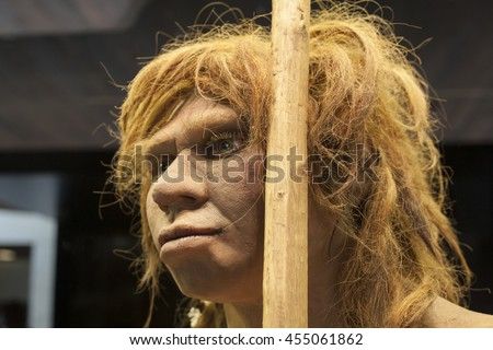 Madrid, Spain - July 10, 2016: Life-sized sculpture of Neanderthal female at National Archeological  Museum of Madrid
