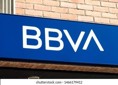 MADRID, SPAIN - JULY 15, 2019. BBVA logo on BBVA bank branch office. BBVA is the second largest bank in Spain