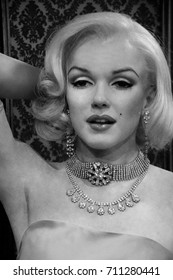 MADRID, SPAIN - JULY 16, 2017: Black and white photo of a figure of the famous Hollywood actress Marilyn Monroe with a diamond necklace and a pink dress in the wax museum