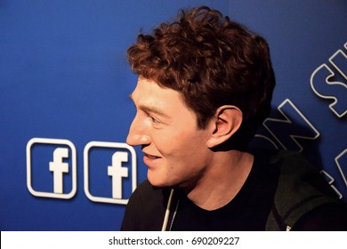 MADRID, SPAIN - JULY 17, 2017: Portrait figure of facebook creator Mark Zuckerberg with blue background with letters