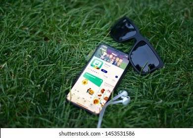 Madrid, Spain - July 17, 2019; Bitmoji Iphone App with Sunglasses on the Grass