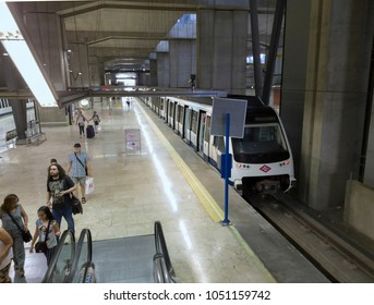 Madrid, Spain - July 20 2017: Barajas International Airport Terminal metro. Line 8 metro station and coach inside MAD Adolfo Suarez airport with passengers heading to Nuevos Ministerios.