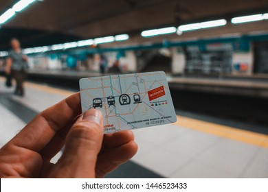 Madrid, Spain. July 2019: Hand with Public transport Multi card of Madrid at an underground metro station
