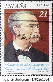 MADRID, SPAIN - JULY 21, 2020. Vintage stamp printed in Spain shows Antonio Canovas del Castillo, a Spanish politician and historian known principally for serving six terms as Prime Minister