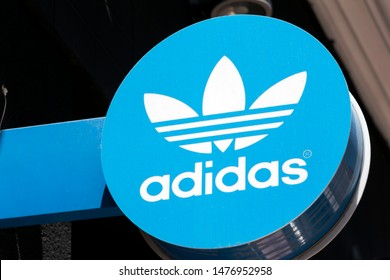 MADRID, SPAIN - JULY 23, 2019.  Adidas logo on Adidas store. Adidas is a german company that designs and manufactures shoes, clothing and accessories
