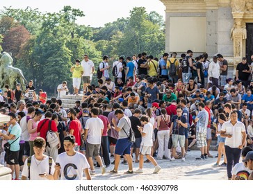 MADRID, SPAIN - JULY 28, 2016: A group of young people playing with their mobile phones to the Pokemon game in the Retiro park in Madrid. Hundreds of people gathered in Madrid to play the Pokemon game