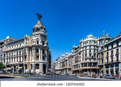 MADRID, SPAIN – JULY 29, 2018: The Metropolis Building (Edificio Metropolis), one of the most recognizable landmarks of Madrid, designed by Jules and Raymond Fevrier, inaugurated in 1911.