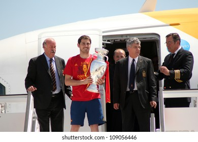 MADRID, SPAIN  JULY 7: Iker Casillas and Vicente Del Bosque show the trophy upon arrival to Madrid after winning the 2012 Eurocup. On July 7, 2012 at Barajas airport.