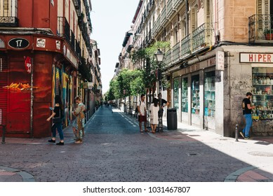 Madrid, Spain - July 9, 2017: Street scene in Malasa a district in Madrid. Malasa a is one of the trendiest neighborhoods in Madrid, well known for its counter-cultural scene.