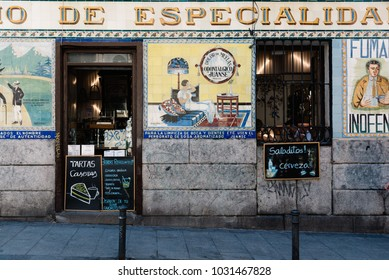 Madrid, Spain - July 9, 2017: Typical bar in Malasa a district in Madrid. Malasa a is one of the trendiest neighborhoods in Madrid, well known for its counter-cultural scene.