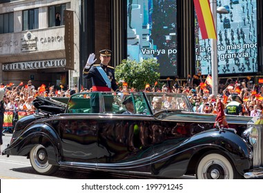 MADRID, SPAIN - JUN 19: Pageant coronation of Philip VI through the streets of Madrid, June 19, 2014 in Madrid, Spain. Thousands of people greeted the new king who paraded a majestic Rolls Royce.
