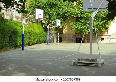 Madrid, Spain - Jun 4, 2015: Outdoor basketball court in a public high school.