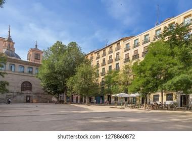 MADRID, SPAIN - JUN 9, 2017: Thatched square (Plaza de la Paja). Left - Episcopal chapel or Capilla de Nuestra Señora y San Juan de Letrán, XVI century