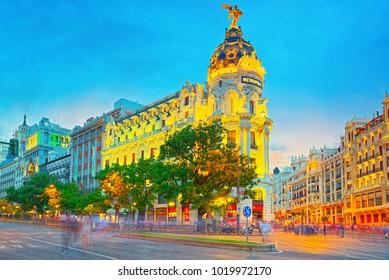 Madrid, Spain - June 04, 2017 : Gran Via Street in Madrid, after sunset, traffic lights on Gran Via, main shopping and  financial street in Madrid at night.