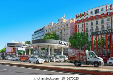 Madrid, Spain - June 05, 2017 : City view of Madrid in the downtown near railways station Atocha. Gas station - Repsol Oil with cars.