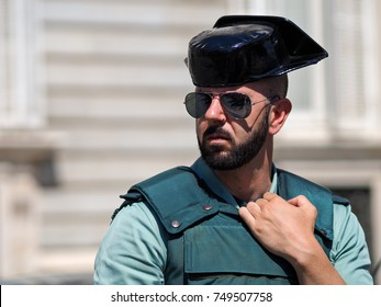 Madrid, Spain - June 06: Unidentified guaard stands in front of Royal Palace on June 06, 2015 in Madrid, Spain