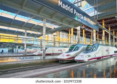 Madrid, Spain - June 08, 2017 : Modern hi-speed passenger train of Spanish railways company-Renfe, on Madrid railways station Puerta de Atocha.