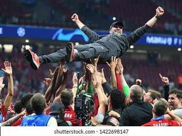 MADRID, SPAIN - JUNE 1, 2019: Liverpool manager Jurgen Klopp is thrown in the air after the award ceremony held after the 2018/19 UEFA Champions League Final.