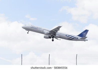 MADRID, SPAIN - JUNE 14th 2015: Plane Airbus A321, of Air France airline, is taking off from Madrid - Barajas, Adolfo Suarez, airport, on June 14th 2015. Member of Skyteam alliance. Day with clouds.