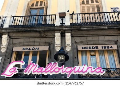 MADRID, SPAIN – June 15, 2018:  Famous sign of La Mallorquina one of the best patisserie in Madrid. The store is coffee shop-bar and the bakery renowned in Puerta del Sol since 1894