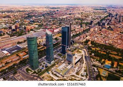 MADRID, SPAIN - JUNE 16, 2019: High view of four modern business skyscrapers (Cuatro Torres) in Madrid, Spain