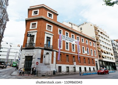 Madrid, Spain - June 2, 2018: Outdoor view of squatted building in Madrid. It is a called La Ingobernable and is located in front of Prado Museum. The banner says: Withous us, women, the world stop