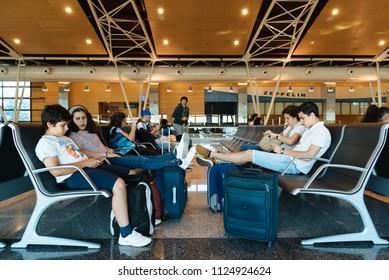Madrid, Spain - June 20, 2018: Unidentified people waiting in boarding gate lounge in  Barajas - Adolfo Suarez Airport