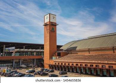 MADRID, SPAIN - June 2019: Building and clock tower at the Atocha Railway station in Madrid, Spain