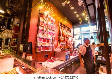 MADRID, SPAIN - June 2019: Mercado de San Miguel in Madrid. Interior of the shop on the market selling big choice of Traditional Spanish Jamon, Madrid, Spain