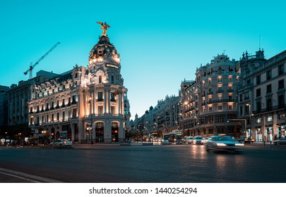 Madrid, Spain. June 2019: Traffic on the crossing Alcala and Gran Via street in Madrid by twilight.The Gran Via is unofficially considered main street of Spain capital.