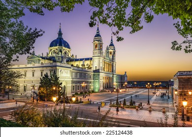 Madrid, Spain at La Almudena Cathedral and the Royal Palace.