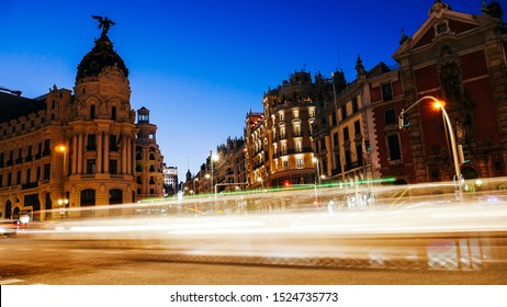 Madrid, Spain long exposure light streaks from moving vehicles at Calle de Alcala and Gran Via.